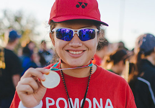 Pomona Valley athlete shows off the medal she earned at Summer Games.