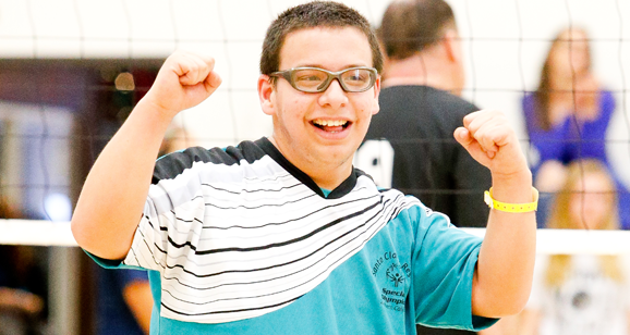 Volleyball athlete cheers for a win at Fall Games.