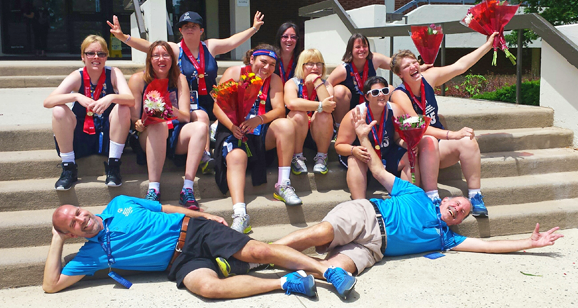 Coaches pose with team after awards at the 2014 USA Games